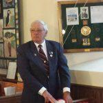 The Chairman of Le Cercle De Carteret - Mike De Carteret with the memorial plaque